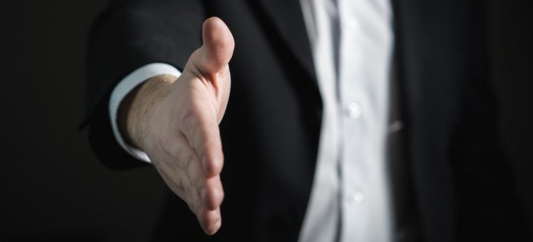 Image of a businessman offering a handshake.