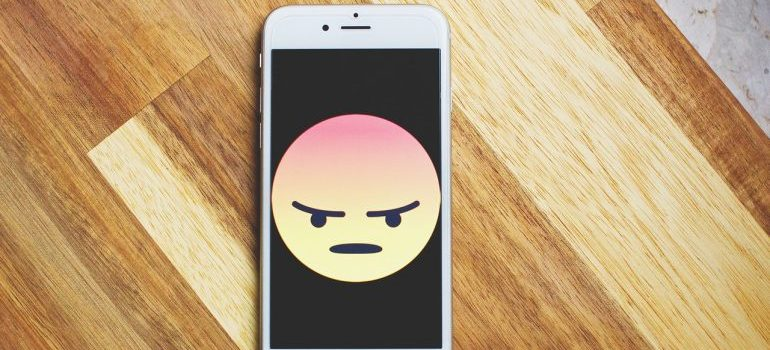 Image of unhappy emoji on iPhone