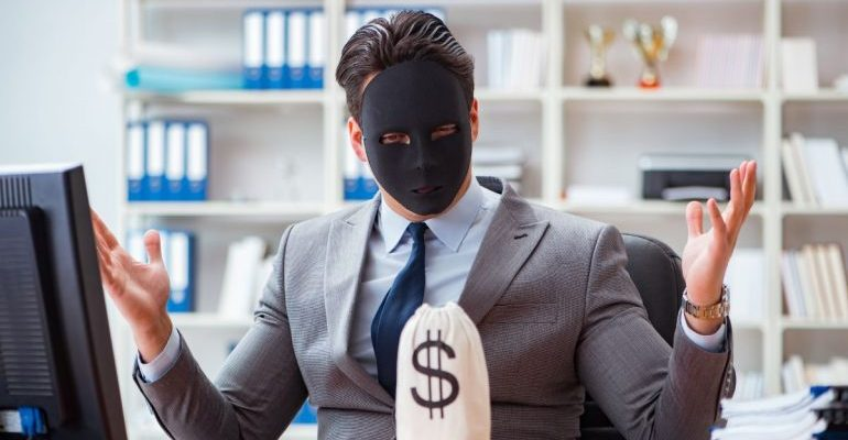 Businessman with black mask and money bag in front of him
