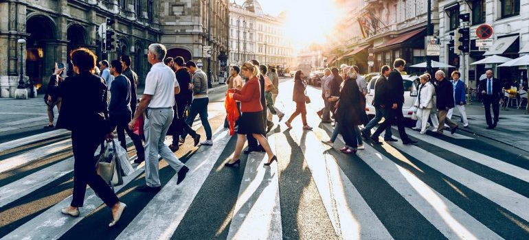 various people crossing the street, representing different ways to satisfy customers needs