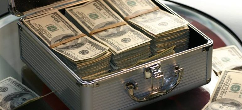 A metal briefcase full of US dollars.