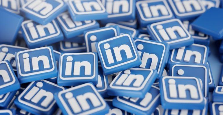 A stack of plastic LinkedIn icons