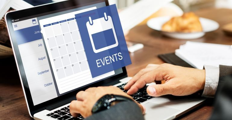 Person looking at calendar on laptop