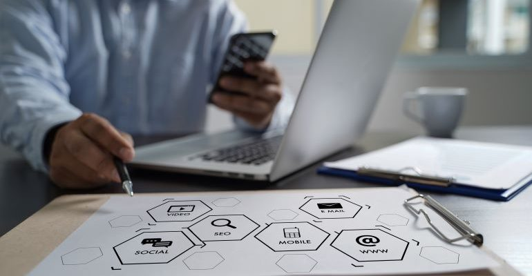 Person with a laptop and SEO metrics icons