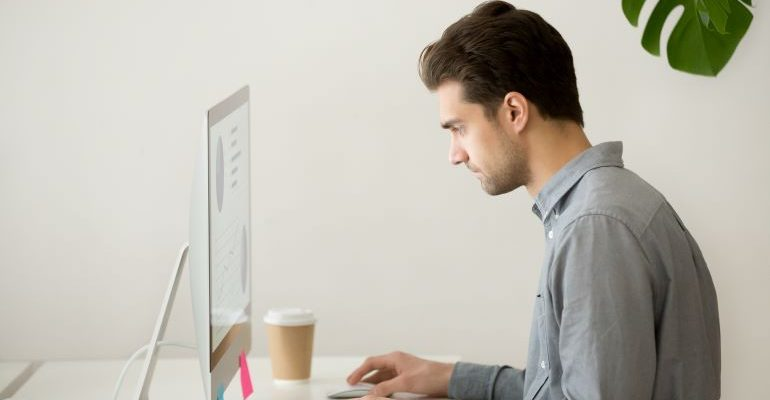 Person looking at laptop