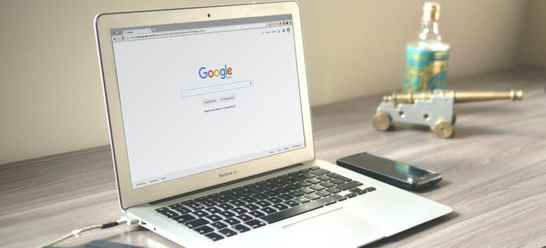 a laptop computer with google website
