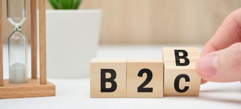 B2B switching to B2C - wooden dice with letters and numerals.