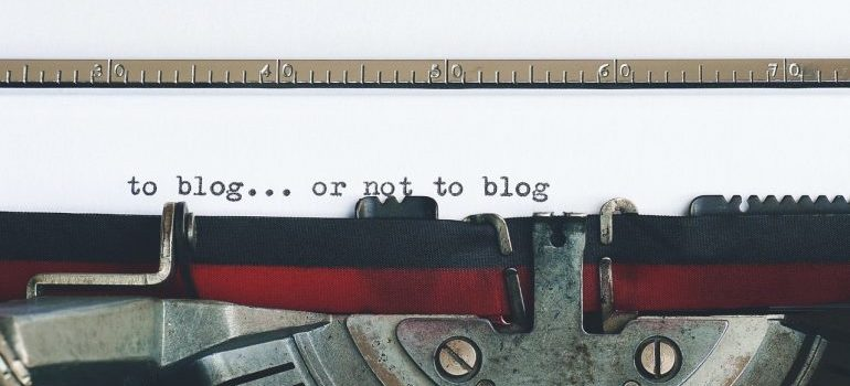 a typewriter with words to blog or not to blog typed on a piece of paper