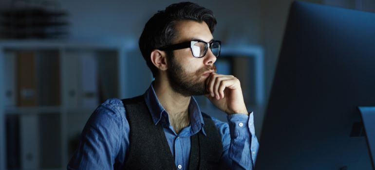 Businessman looking at laptop - one of the different types of site visitors.