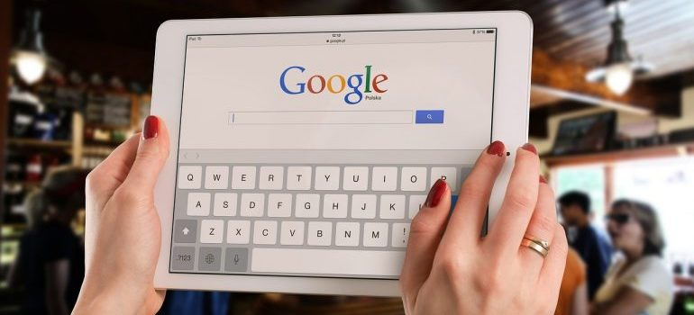 a tablet device displaying Google website, representing the question of whether or not it is worth marketing your business to other search engines