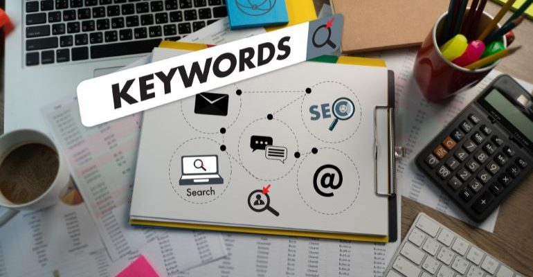 Work desk with an illustration of Keywords on it.