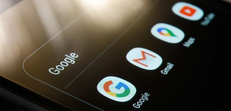 Different Google app icons on black mobile phone screen.