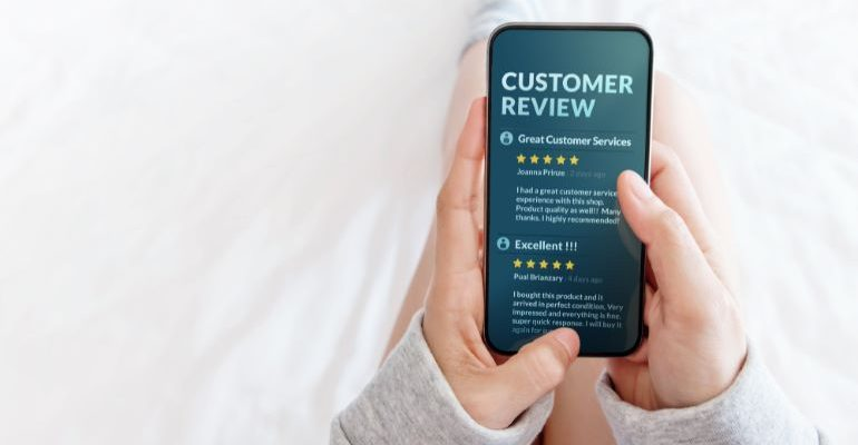Person looking at customer reviews on a phone.